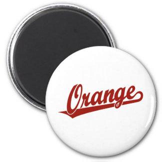 Orange script logo in red magnets