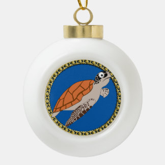 Orange sea turtle swimming with a gold frame ceramic ball christmas ornament