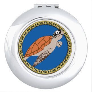 Orange sea turtle swimming with a gold frame mirror for makeup