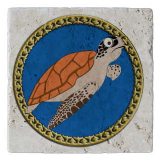 Orange sea turtle swimming with a gold frame trivet