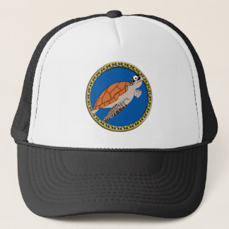 Orange sea turtle swimming with a gold frame trucker hat