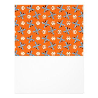 Orange skis and snowflakes pattern flyers