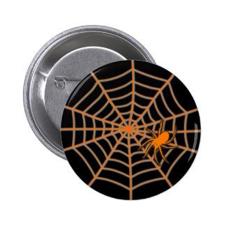 Orange spider and web on black 6 cm round badge