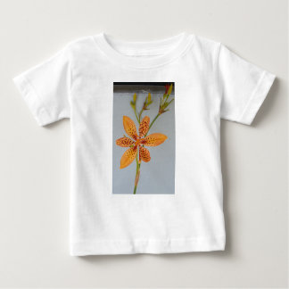 Orange spotted Iris called a  Blackberry lily Baby T-Shirt