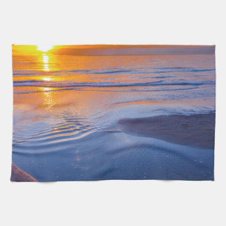 Orange sunset at sea tea towel