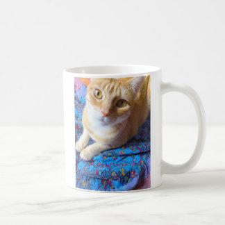 Orange tabby on quilt coffee mug