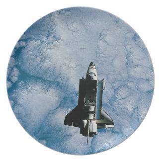 Orbiting Space Shuttle Plate