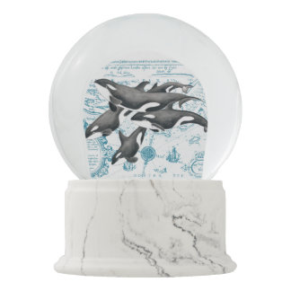 Orca whales family ancient blue snow globe