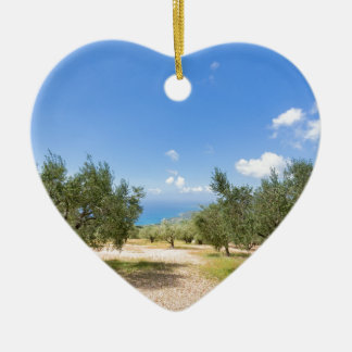 Orchard with olive trees at sea in  Greece Ceramic Heart Decoration