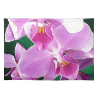 Orchid blooms closeup in pink placemat