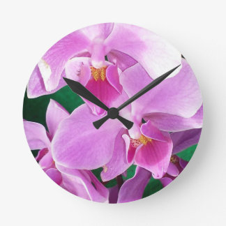 Orchid blooms closeup in pink round clock