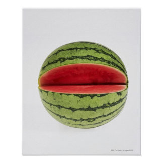 Organic watermelon with a slice cut into it, on print