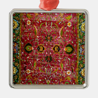 Oriental rug in red and green metal ornament