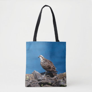Osprey on the rocks tote bag