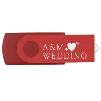 our wedding photos saved on a red USB flash drive