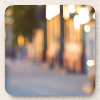 Out of focus image of streets and buildings drink coasters