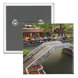 Outdoor cafe along River Walk and bridge over 2 15 Cm Square Badge