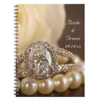 Oval Diamond Ring and White Rose Wedding Notebooks
