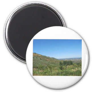 Over the hills 6 cm round magnet