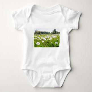 Overblown dandelions in green dutch meadow baby bodysuit