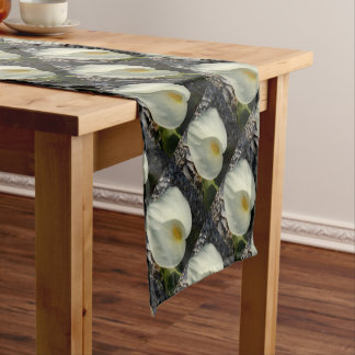 Overhead View of A White Calla Lily Against Pebble Short Table Runner