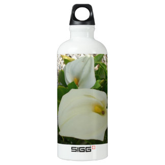 Overhead View Of Two Calla Lilies In A Garden Water Bottle