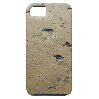 Overhead view on the wet sand at the beach with fo iPhone 5 covers