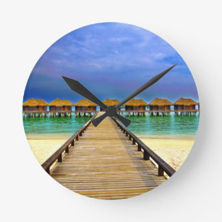 Overwater bungalows at Sheraton Maldives Round Clock