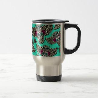 Owl holding sugar skull on mint green base. stainless steel travel mug