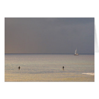 Paddle boarders at sunset in Maui Card