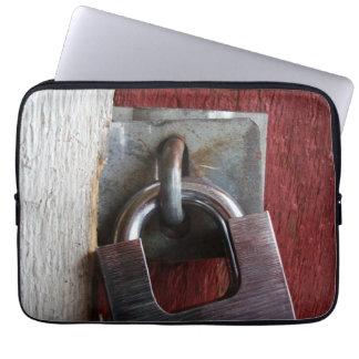 Padlock on old door computer sleeves