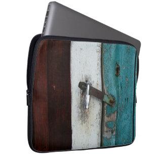 Padlock on old door laptop sleeves
