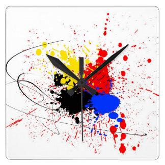 Paint Splatter Art Black Blue Red Yellow Square Wall Clock