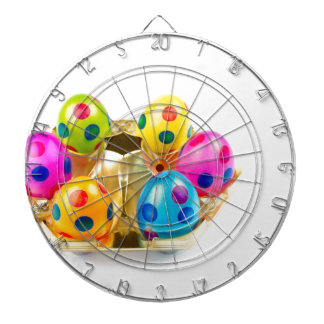 Painted easter eggs in gold tray isolated on white dartboard