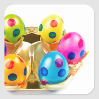 Painted easter eggs in gold tray isolated on white square sticker