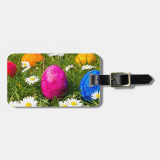 Painted easter eggs in grass with daisies bag tag