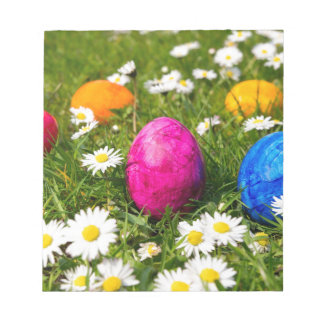 Painted easter eggs in grass with daisies notepad