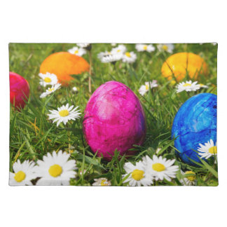Painted easter eggs in grass with daisies placemat
