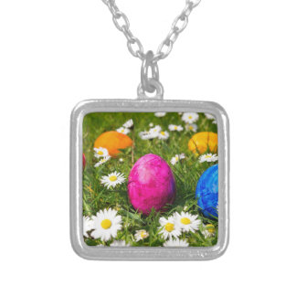 Painted easter eggs in grass with daisies silver plated necklace