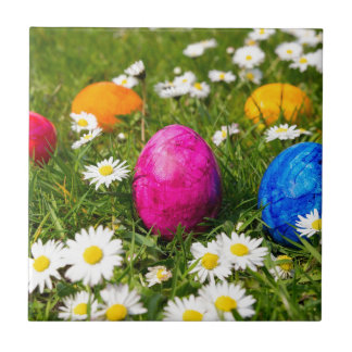 Painted easter eggs in grass with daisies tile