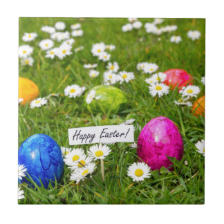 Painted Easter eggs in grass with white daisies Ceramic Tile