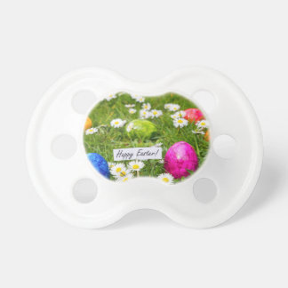 Painted Easter eggs in grass with white daisies Dummy