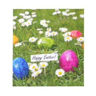 Painted Easter eggs in grass with white daisies Notepad