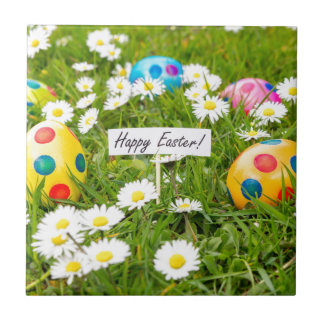 Painted Easter eggs in grass with white daisies Tile