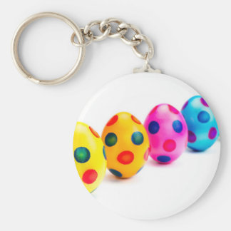 Painted easter eggs in row on white background key ring