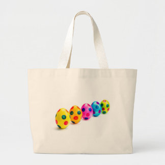 Painted easter eggs in row on white background large tote bag