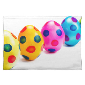 Painted easter eggs in row on white background placemat