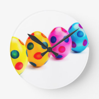 Painted easter eggs in row on white background round clock