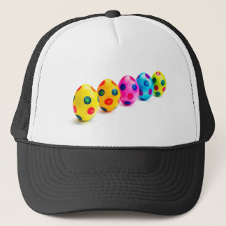 Painted easter eggs in row on white background trucker hat