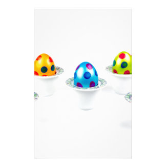 Painted easter eggs standing in porcelain egg cups stationery